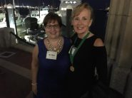 Janet Kacskos, APR, Fellow, on right poses for a photo with National Board Member at Fellows Dinner